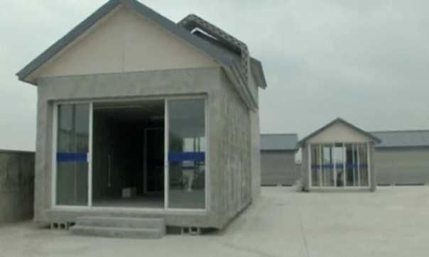 a concrete and construction waste house printed by a 3D printer