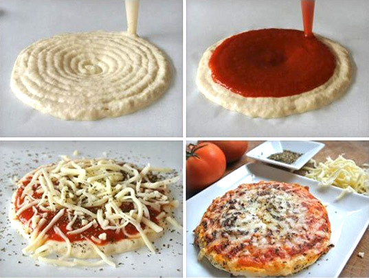 dough is extruded, then sauce, then cheese, then it is baked