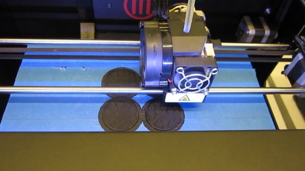 3D printer prints a platform for object
