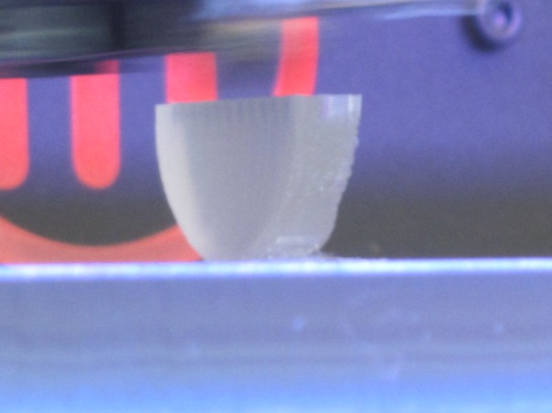 printer nozzle adds layers to 3D object